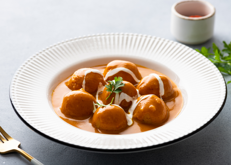 Malai Kofta Curry is one of the most popular Indian curries and is often served with crispy butter naan.